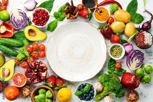 Fototapeta Diet food concept: fresh vegetables and fruits on white wooden background. Free space for your text. obraz