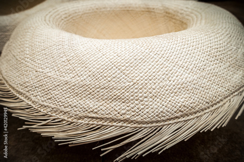 Panama hat semifinished made of toquilla straw on factory in Cuenca, Ecuador, popular as tropical and seaside accessories owing to their ease of wear and breathability.