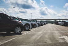 Large Parking Lot In The World Famous Amusement Park. Close-up Of Cars In A Parking Lot On A Sunny Day. Toning