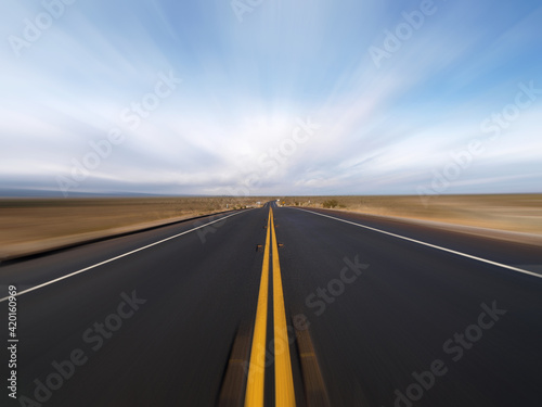 View of Pearblossom Highway with motion blur near Victorville in the Mojave Desert area of San Bernardino County California Fotobehang