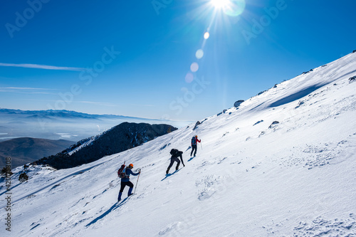 Canvas Print Risky hikes in slopes and steep areas in winter mountaineering