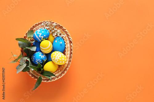 Fototapeta Beautiful Easter eggs on color background