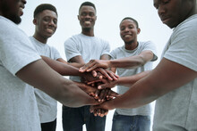 Group Of Diverse Guys Making A Tower Out Of Hands