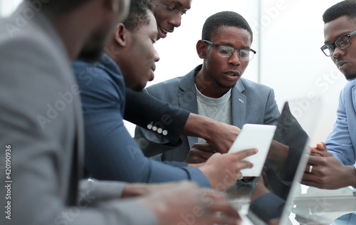 Obraz business team discussing documents at working meeting. - fototapety do salonu