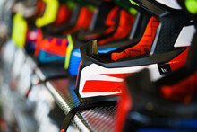 A Row Of Motorcycle Helmets On The Shelf In The Store