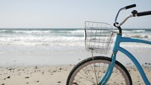 Blue Bicycle, Cruiser Bike By Ocean Beach Pacific Coast, Oceanside California USA. Summertime Vacations, Sea Shore. Vintage Cycle On Sand. Clear Sky And Water Waves. Waterfront Summer Near Los Angeles