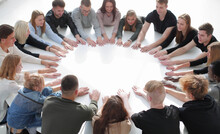 Group Of Diverse Young People Joining Their Palms In A Circle