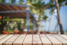 Empty Wood Table Top And Blurred Summer Beach In Tropical Resort Banner Background - Can Used For Display Or Montage Your Products.