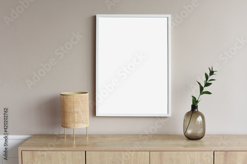 Obraz Blank picture frame mockup on gray wall. White living room design. View of modern scandinavian style interior with artwork mock up on wall. Home staging and minimalism concept - fototapety do salonu