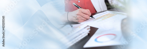 Woman analysing marketing data; panoramic banner