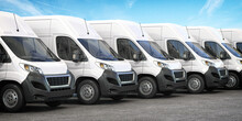 Delivery Vans In A Row.  Express Delivery And Shipment Service Concept.