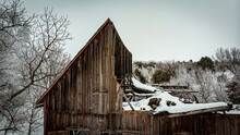 Old Rundown Barn Covered In Snow
