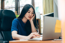 Young Adult Business Freelancer Asian Woman Working At Home Office.