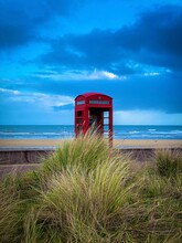 Red Phone Box On The Normandy Beach