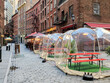 Outdoor dining tables in bubbles along Stone Street during the coronavirus pandemic in downtown Manhattan, New York City.