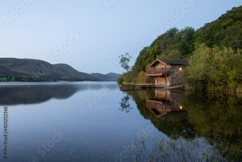 View out to Ullswater on a calm morning with boathouse Fototapeta