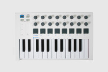 White Midi Keyboard With Knobs And Pads