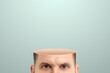 Close-up of a man's head cut off from the crown, no brain. Vacuum in the human head. Creative background.