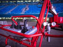Concert Equipment. Lifting-car At Stadium. Hoist Control Levers. Machine For High-rise Work Inside Concert Venue. High-altitude Work During Organization Of Concert. Fragment Of Lifting Work Platform