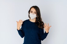 Beautiful Young Woman Wearing An Anti Viurs Protection Ffp2-mask To Prevent From Corona Covid-19 And Sars Cov 2 Infection White Background Copy Space