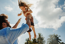 Father And Daughter Playing On A Holiday