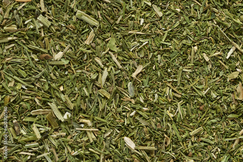 Fotografia Pile of dried green dill texture or background.