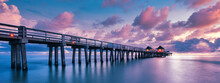 A Scenic Colorful Sunset At The Beach With A Breathtaking Boardwalk