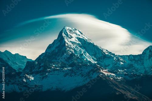 Fotografie, Obraz Cloudscape sunrise above Annapurna Peak in the Himalaya range, Annapurna region,