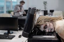 Young Spooky Businesswoman With Zombie Greasepaint On Face Keeping Head On Screen Of Xerox Machine