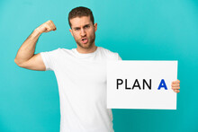 Handsome Blonde Man Over Isolated Blue Background Holding A Placard With The Message PLAN A Doing Strong Gesture