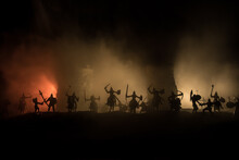 Medieval Battle Scene. Silhouettes Of Figures As Separate Objects, Fight Between Warriors At Night. Creative Artwork Decoration. Foggy Background.