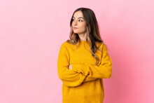 Young Romanian Woman Isolated On Pink Background Keeping The Arms Crossed