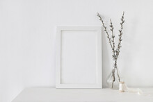 Easter Spring Still Life. Blank Vertical Picture Frame Mockup On White Wooden Table. Blooming Pussy Willow Branches With Catkins In Glass Vase. Art Concept. Scandinavian Interior Design, No People.