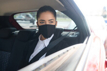 Business Woman On Her Way To Work In Car.