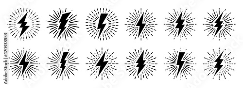 Fotografia Set of vintage lightning bolts and sun rays isolated on white background