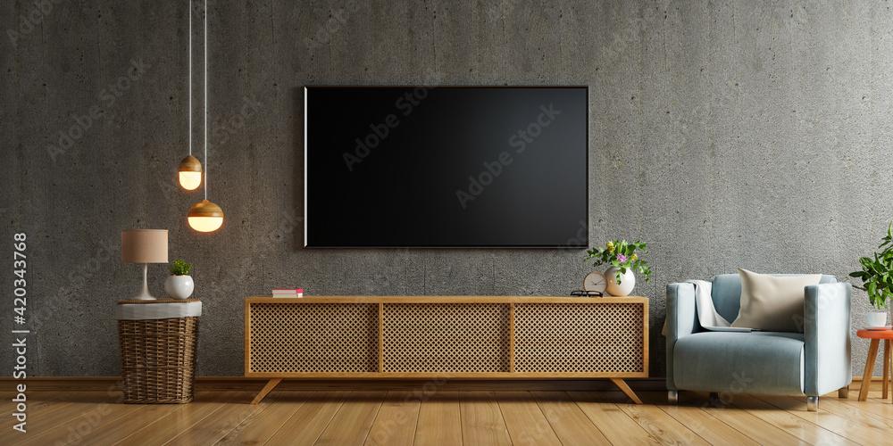 Fototapeta Smart tv mockup on cabinet in living room the concrete wall.