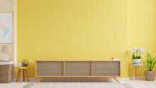 Cabinet TV In Modern Living Room With Lamp,table,flower And Plant On Yellow Wall Background.
