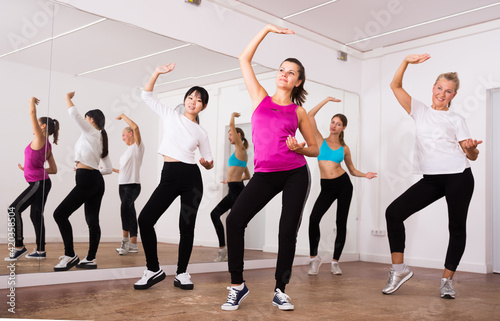 Fototapeta Women dancing aerobics at lesson in the dance class