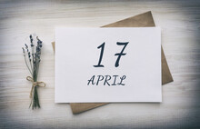 April 17. 17th Day Of The Month, Calendar Date.White Blank Of Paper With A Brown Envelope, Dry Bouquet Of Lavender Flowers On A Wooden Background. Spring Month, Day Of The Year Concept