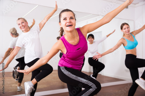 Fotografia, Obraz Cheerful different ages women learning swing steps at dance class