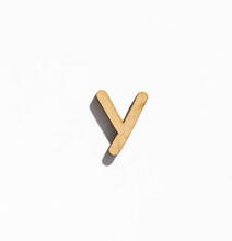 Wooden Letter Y Isolated On A White Background, English Alphabet From Natural Materials For Children, Eco Friendly Concept