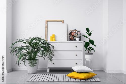 Fototapeta Chest of drawers near light wall in room obraz