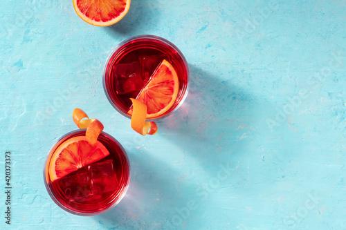 Fototapeta Negroni cocktails decorated with blood oranges, top shot obraz na płótnie