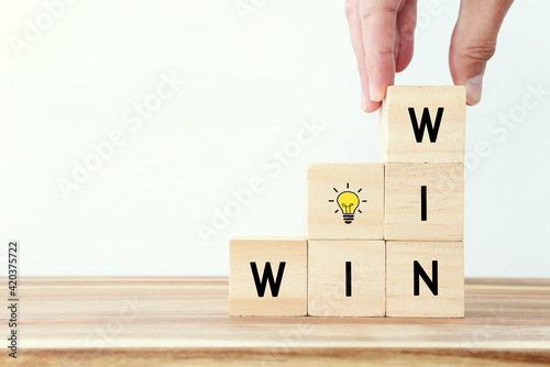 Canvas Print Wooden cubes stack with the text win-win-situation