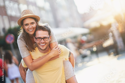 Happy tourists sightseeing during summer holidays