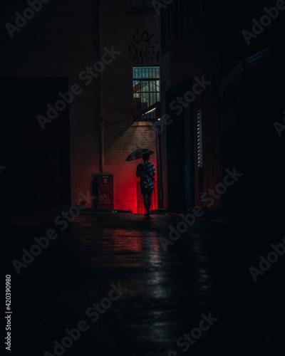 Fotografering Man alone in a dark alleyway