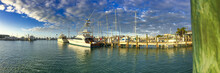 KEY WEST, FL - FEBRUARY 2016: Key West Promenade Along The Ocean With City Port On A Sunny Winter Day