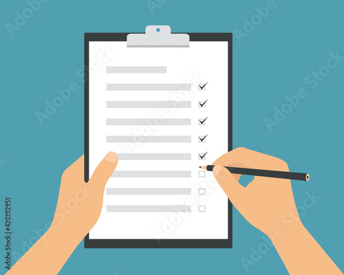 Obraz Flat design illustration of a man or woman's hand holding a pencil and filling out a to-do list. White paper on green background, vector - fototapety do salonu