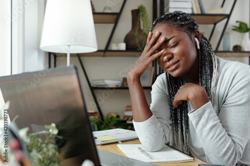 Sad Black female student almost crying after not passing text online when studyi Fototapet