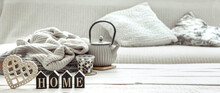 A Teapot With Hygge Decor Details And A Decorative Word Home On The Table In The Living Room.